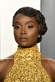 Kiki Layne rocked an elaborate braided updo at the 2020 Vanity Fair Oscar party.