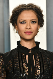 Gugu Mbatha-Raw accessorized with simple gold dangle earrings.
