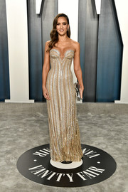 Jessica Alba went for sexy glamour in a figure-hugging metallic strapless gown by Atelier Versace at the 2020 Vanity Fair Oscar party.