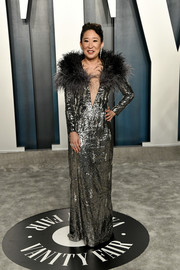 Sandra Oh got majorly glam in a silver sequined gown with a feather collar at the 2020 Vanity Fair Oscar party.
