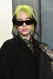 Billie Eilish looked mysterious wearing her dark glasses.
