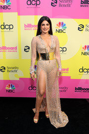Priyanka Chopra-Jonas oozed sex appeal wearing this sheer beige gown with a plunging neckline and a high slit at the 2021 Billboard Music Awards.