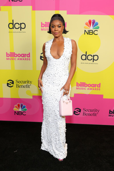 Gabrielle Union sizzled in a low-cut white paillette gown by Prada at the 2021 Billboard Music Awards.