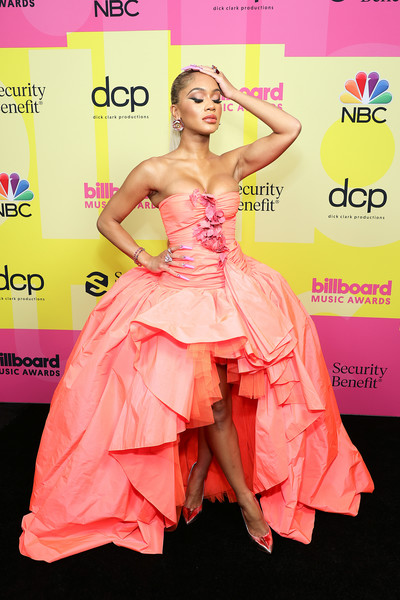 Saweetie went full-on glam in a strapless coral ballgown by Giambattista Valli Couture at the 2021 Billboard Music Awards.