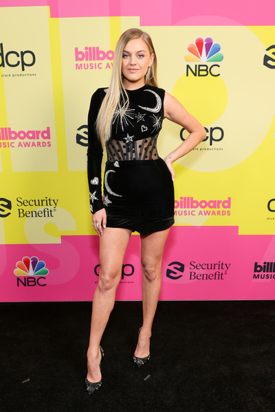 Kelsea Ballerini was modern and chic in a one-sleeve black corset dress with moon, star, and heart embellishments at the 2021 Billboard Music Awards.