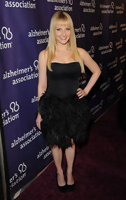 Melissa Rauch donned this strapless balck corset dress with a skirt of feathers on the Alzheimer's Association 'A Night at Sardi's' red carpet.