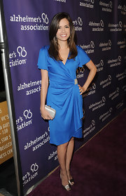 Torrey Devitto wore this blue draped dress with a hip broach on the Alzheimer's Association 'A Night at Sardi's' red carpet.