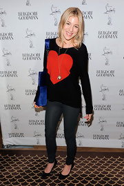 Dani topped off her whimsical sweater with black pumps.