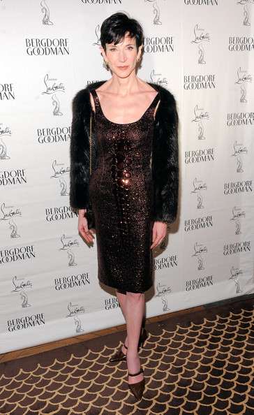 AMy Fine Collins dazzled in a beaded crocodile embossed cocktail dress for the Christian Louboutin celebration.