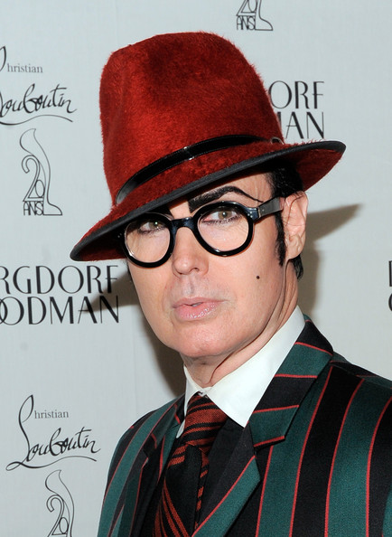 Patrick McDonald wore a vibrant red fedora to the Christian Louboutin celebration for this statement look.