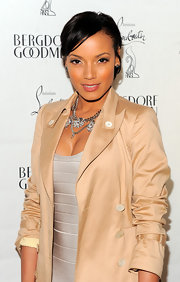 Selita Ebanks accessorized her silvery look with a chain statement necklace at the Christian Louboutin celebration.