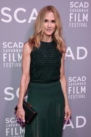 Holly Hunter styled her green outfit with a black satin clutch for the SCAD Savannah Film Festival screening of 'Molly's Game.'