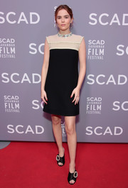 Zoey Deutch polished off her sweet look with a pair of embellished satin mules, also by Miu Miu.