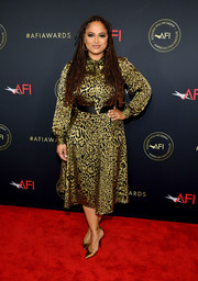 Ava DuVernay sported a gold leopard-print pussybow blouse by Baukjen at the 2020 AFI Awards.