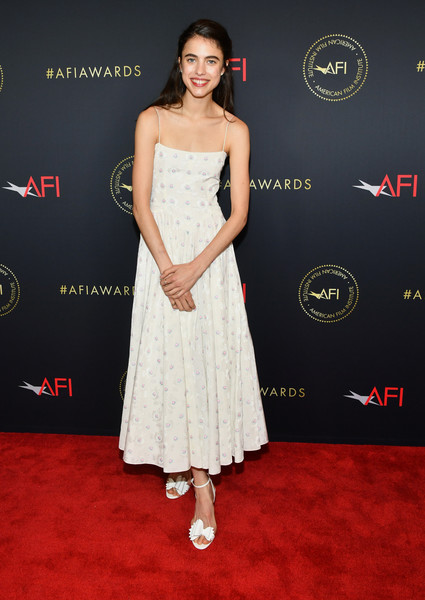 Margaret Qualley paired her cute frock with bowed white sandals by Christian Louboutin.