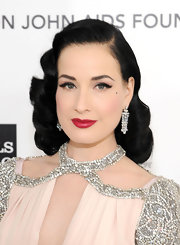 Dita Von Teese wore her hair in sleek waves and curls at the Elton John Oscar viewing party.
