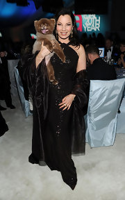 Fran Drescher posed with her pup in this glittering black gown at the Elton John Oscar viewing party.