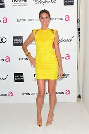 Heidi Klum topped off her yellow frock with trendy cap-toe pumps.