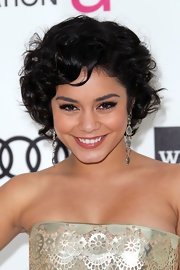 Vanessa Hudgens attended the Elton John Oscar viewing party wearing her jaw-length bob in a mass of bouncy curls.