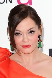 Rose McGowan attended the 20th Annual Elton John AIDS Foundation Oscar viewing party wearing a pair of platinum and 18-carat gold, diamond, carved jade, coral and black enamel earrings.