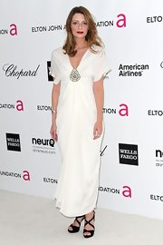Mischa Barton wore this draped white dress to the Elton John Oscar viewing party.