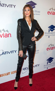 Teri Hatcher worked a tough, androgynous vibe at the Fulfillment Fund Stars Benefit Gala in a black pantsuit with leather sleeves and trousers.