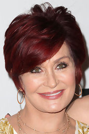 Sharon Osbourne topped off her look with a layered razor cut.