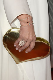 Sharon Osbourne added some spice to her white suit when she opted to carry this gold heart-shaped clutch.