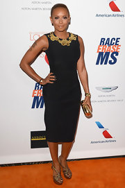 Melanie Brown chose a classic shift dress with a floral gold embellished neck for her look at the Love to Erase MS.