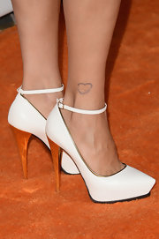 Catherine Bell chose these white evening pumps with an orange heel and ankle strap for her evening look.