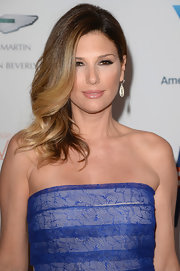 Daisy Fuentes showed off her golden waves with a deep side-parted 'do.