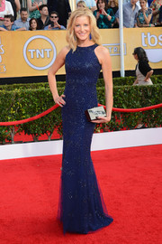 Anna Gunn chose a beaded blue column dress by Monique Lhuillier for her SAG Awards red carpet look.