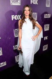 Danielle Vasinova donned a white column dress, made more dramatic with the addition of a flowing cape, for the 20th Century Fox Golden Globes party.