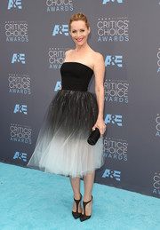 Leslie Mann paired her lovely dress with beaded black T-strap pumps by Christian Louboutin.