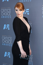 Bryce Dallas Howard paired an Edie Parker geometric hard-case clutch with a plunging black dress for the Critics' Choice Awards.