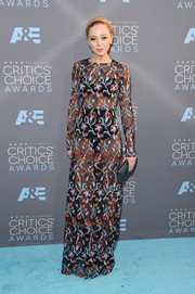 Portia Doubleday showed her daring side in a sheer, embroidered mesh dress by Novis at the Critics' Choice Awards.