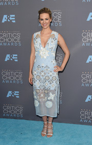 January Jones chose chic white strappy sandals by Bionda Castana to finish off her outfit.