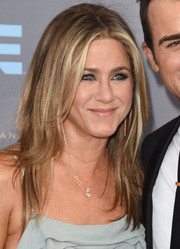 Jennifer Aniston kept her styling low-key with some small diamond pendants by Anita Ko, Suzanne Kalan, and Carbon and Hyde.