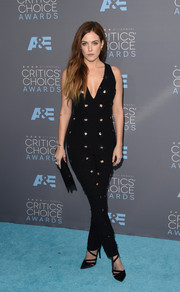 Riley Keough cut a curvy figure in a body-con black cutout jumpsuit by Dior at the Critics' Choice Awards.