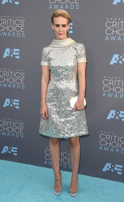 Sarah Paulson went for total shine with a Judith Leiber mirrored clutch and a pair of satin pumps.