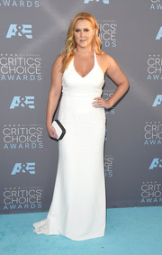 Amy Schumer matched her gown with a monochrome box clutch by Barneys.