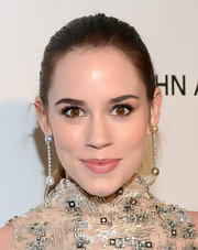 Christa B. Allen was elegant and sophisticated at Elton John's Oscar party in a pearl drop earrings with white diamonds.