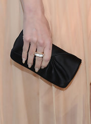 Jaime King opted for a timeless black satin clutch for her Oscar look at Elton John's viewing party.