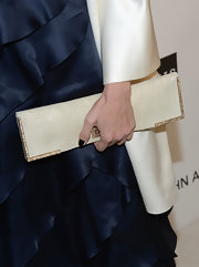Nia Vardalos added some elegance to her Oscar-party look with a champagne satin and crystal clutch.