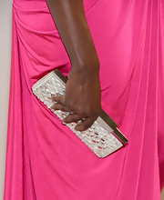 Danai Gurira paired a silver crystal clutch with her hot pink gown for a feminine and flirty Oscar-night look.