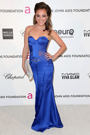 Lauren Mayhew opted for a sleek blue gown with a corset-style bodice for her Oscar-party look.
