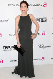 Skylar Grey opted for a classic and sophisticated look at Elton John's Oscar party with this dark green column-style dress.