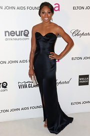 Olympian Allyson Felix showed off her killer arms at Elton John's Oscar party with a navy strapless gown with sweetheart neckline.
