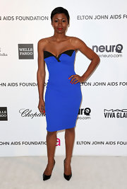 Emayatzy Corinealdi opted for a figure-flattering strapless cocktail dress to wear to the Elton John Oscar party.