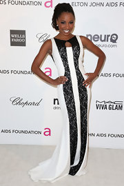 Shanola Hampton accentuated her figure with a white gown detailed with black lace panels and neckline.